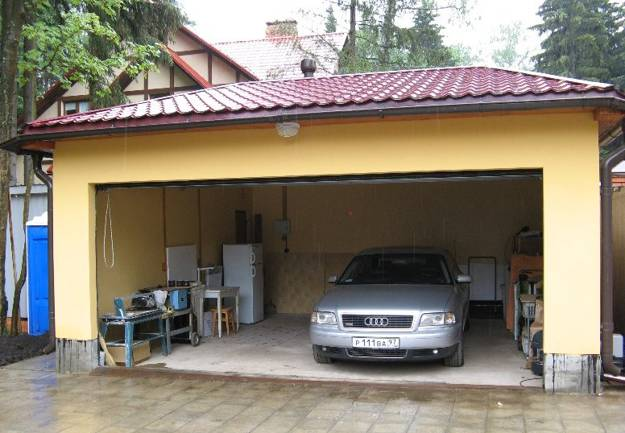 Garage design ideas that will transform your property for Cool car garage ideas
